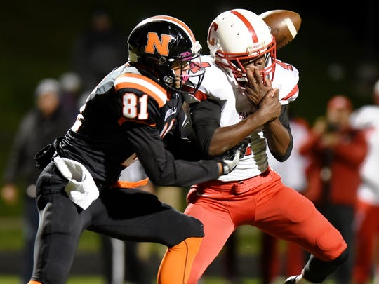 Canton's Steven Walker (right) breaks up a pass intended
