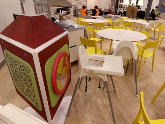 A Play Tree and high chairs in the restaurant at the