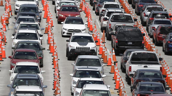 Lines of cars wait at a coronavirus testing site June 26 outside of Hard Rock Stadium in Miami Gardens.