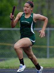 Williamston's Jayda Bush runs her leg of the 4x200 relay during the MHSAA Division 2 track regionals Friday, May 19, 2017, in Williamston, Mich.