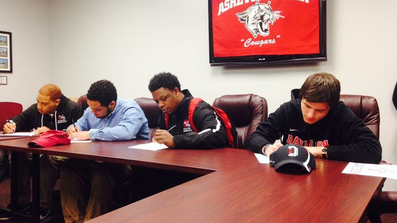 Asheville High seniors Jave Jones, Holton Brown, Tyreek Smith and Alexander Paulk signed to play college football on Wednesday.