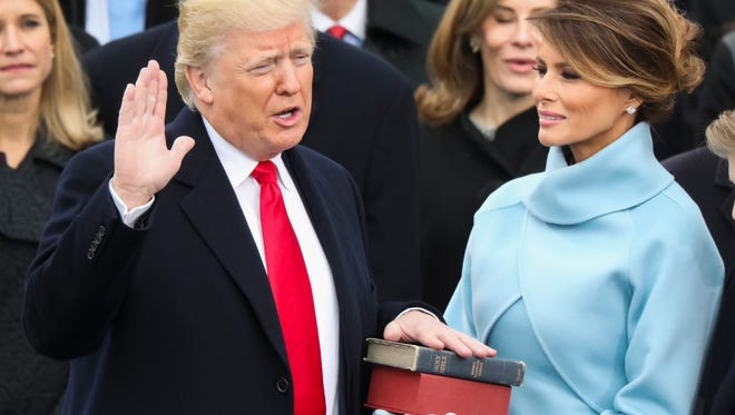 Donald Trump is sworn in as the 45th president of the United States as Melania Trump looks on during the 58th Presidential Inauguration at the U.S. Capitol Friday, Jan. 20, 2017, in Washington.