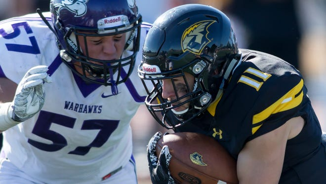 UW-Oshkosh's Riley Kallas runs the ball Saturday on J.J. Keller Field at Titan Stadium in a game against UW-Whitewater September 30, 2017.
