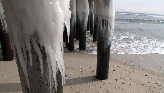 Ice drips from the pilings below Casino Pier in Seaside Heights Monday, Feb. 16, 2015.