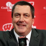 Paul Chryst, Wisconsin's new football coach, laughs while answering questions during an NCAA college football news conference in Madison, Wis. Chryst returned to Wisconsin as head coach to replace Gary Andersen. He takes over a Badgers team that won the Big Ten West title last year.