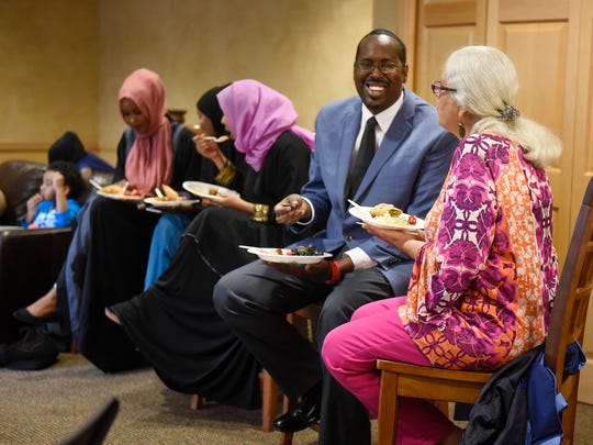 Guests enjoy conversation during a Dine and Dialogue event Saturday, Aug. 26, in St. Cloud.