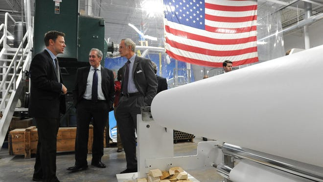 Eric Teather, left, founder of White Optics, gives a tour of its New Caste facility to U.S. Trade Representative Michael Froman and U.S. Senator Tom Carper in 2015. White Optics – a high-efficiency lighting manufacturer near New Castle – was able to secure distribution agreements in South Africa and Brazil following a pair of state-sponsored trade missions in 2013.