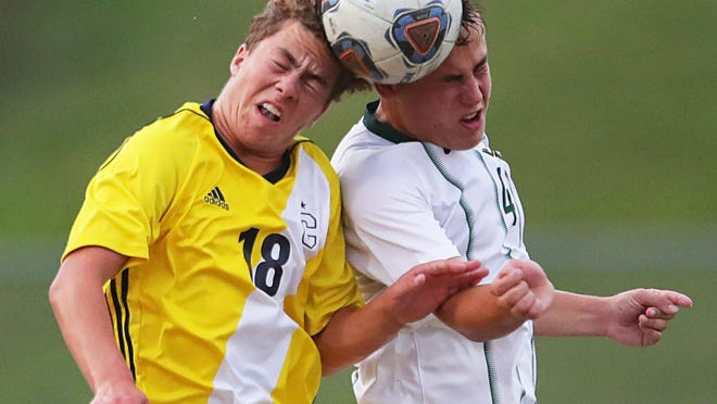 Copley's Matthew Luecke, left, collides with Medina's Jacob Miller as they head the ball at the same time during the first half Wednesday, Sept. 2, 2020, in Copley, Ohio.