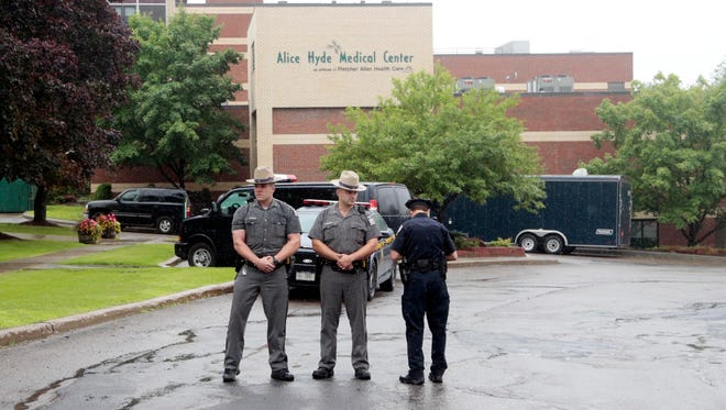 Law enforcement officers stand outside Alice Hyde Medical Center, where David Sweat was transported June 28, 2015, in Malone, New York.