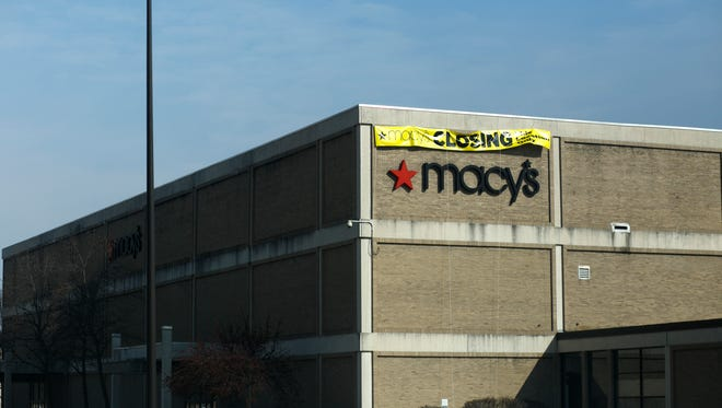 A sign hangs on the side of a Macy's at Upper Valley Mall in Springfield, OH on February 4, 2015.