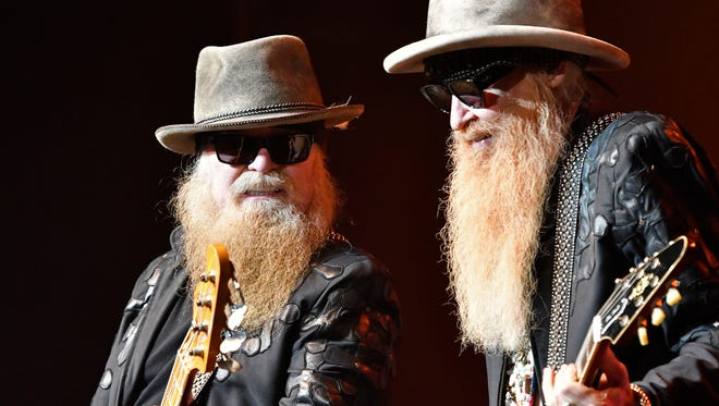 Dusty Hill, left and Billy F. Gibbons of the band ZZ Top performs at the Palace Theatre, Friday, Feb. 24, 2017 in Louisville Ky. (Timothy D. Easley/Special to the C-J)