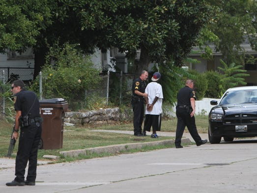 A police officer on a loudspeaker at about 3:45 p.m. was telling a male inside a residence near the intersection of Scott and Franklin to come out of the house, with his hands up.