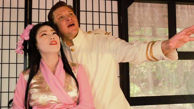 "Seon Duk Kim as Cio-Cio San and Cody Austin as Benjamin Pinkerton star in ""Madama Butterfly."""