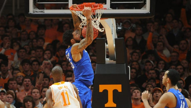 Kentucky forward Willie Cauley-Stein (15) dunks for two of his nine points Tuesday night.