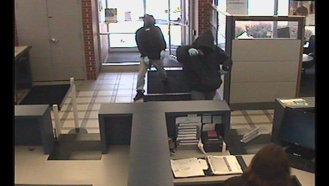 Surveillance footage shows two men allegedly robbing a Henrietta bank Wednesday.