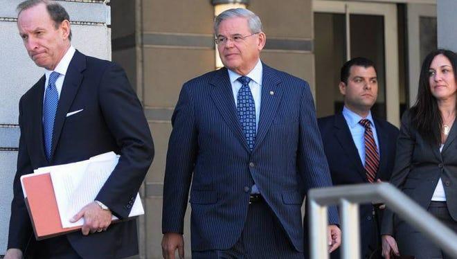 Sen. Robert Menendez (center) leaves federal court in Newark.