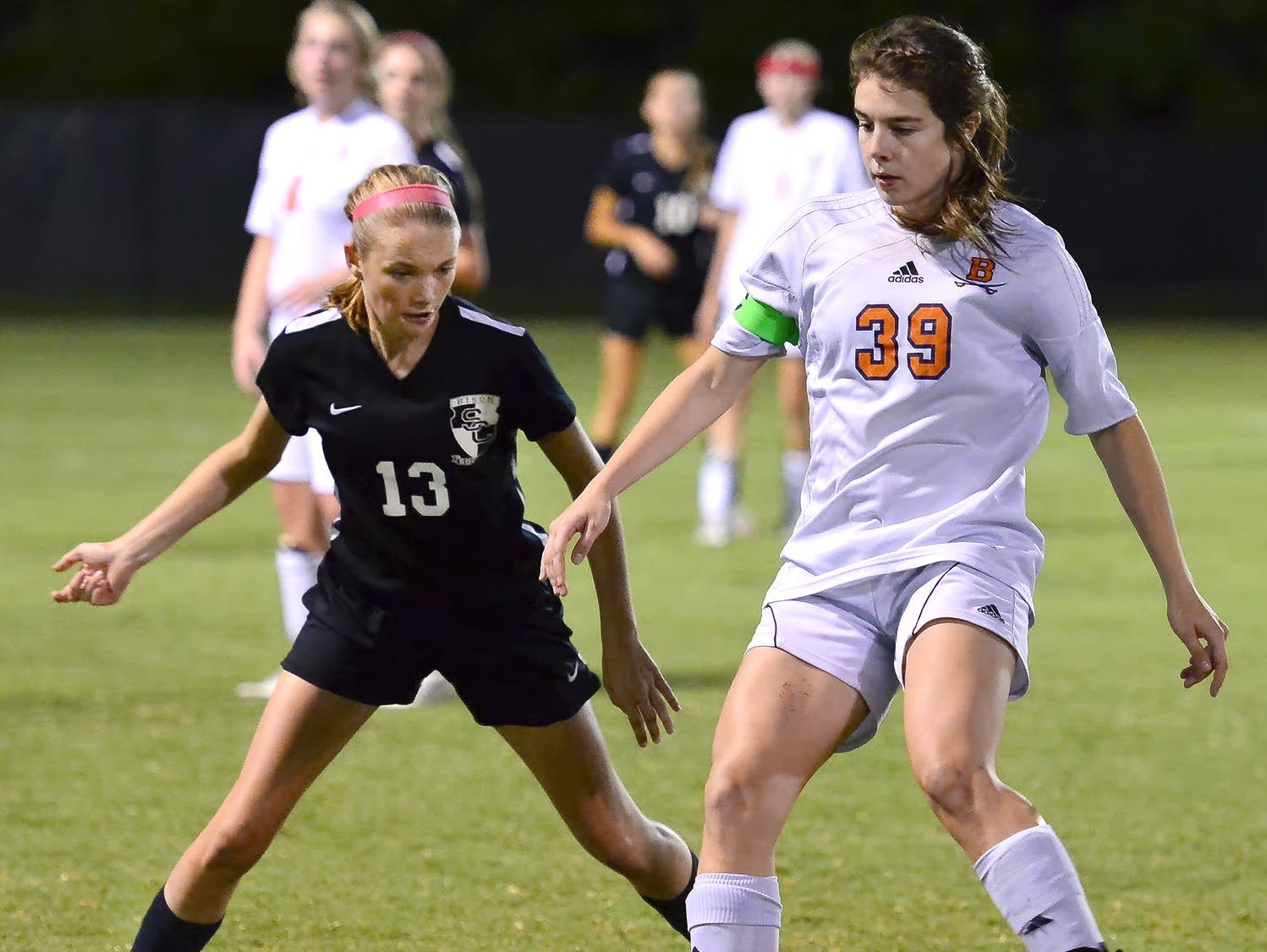 Beech High senior Kendon Curtis (39) maintains possession amidst pressure from Station Camp freshman Carolyn Fitch.