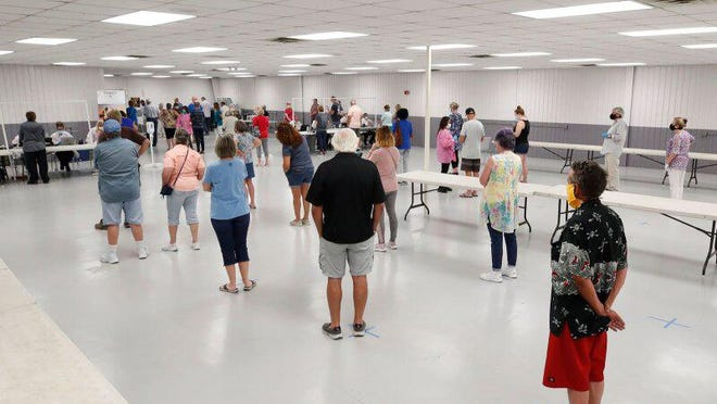 Hundreds of people, using masks and standing six feet apart, took coronavirus antibody tests at the Volusia County Fairgrounds in DeLand, Monday, May 4, 2020.
