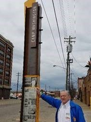 Elmer Hensler, founder of Queen City Sausage, stands by the new monument that celebrates his company.