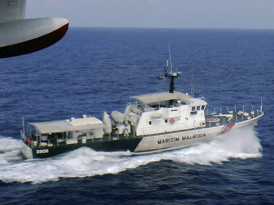 In this photo released by Malaysian Maritime Enforcement Agency, a patrol vessel of Malaysian Maritime Enforcement Agency searches for the missing Malaysia Airlines plane off Tok Bali Beach in Kelantan, Malaysia, Sunday, March 9, 2014. Military radar indicates that the missing Boeing 777 jet may have turned back, Malaysia?s air force chief said Sunday as scores of ships and aircraft from across Asia resumed a hunt for the plane and its 239 passengers. (AP Photo/Malaysian Maritime Enforcement Agency)