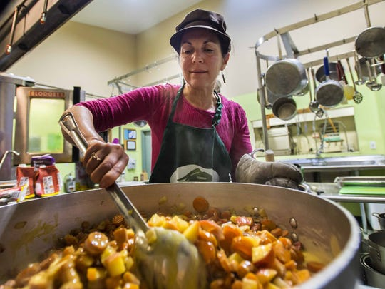 Food writer Melissa Pasanen volunteers as a cook at the Chittenden Emergency Food Shelf in Burlington.