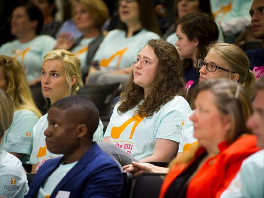 Students listen as University of Tennessee Chancellor Beverly Davenport speaks before the start of Hike the Hill in Heels at Thompson-Boling Arena on April 3, 2017. The hike kicked off Sexual Assault Awareness Month.