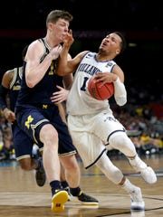 Michigan center Jon Teske (15) defends Villanova guard