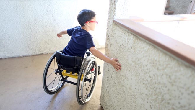 01/03/19 Taya Gray, Special to The Desert SunAsher Loera, 7, uses his hand to turn his wheelchair at his apartment complex in Palm Springs on Thursday, January 3, 2019. Asher has spina bifida and and regularly competes in various sports at the Angel City Games. On Friday, he will demonstrate his use of a racing wheelchair during a panel at the Golden Globes.