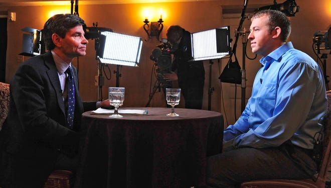 In this photo provided by ABC News, ABC News' chief anchor George Stephanopoulos, left, interviews Ferguson, MO., police officer Darren Wilson, Tuesday, Nov. 25, 2014 in Missouri. The interview will air during ABC News programs and platforms on Nov. 25 and 26.