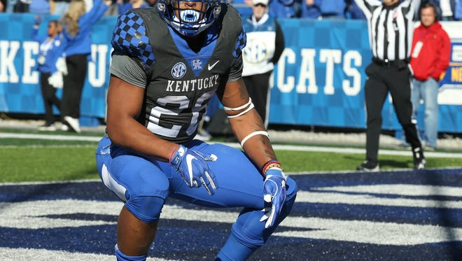 Kentucky's Benny Snell Jr pauses after scoring in the first half.November 25, 2017