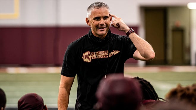 Florida State football coach Mike Norvell addresses his team during a practice.