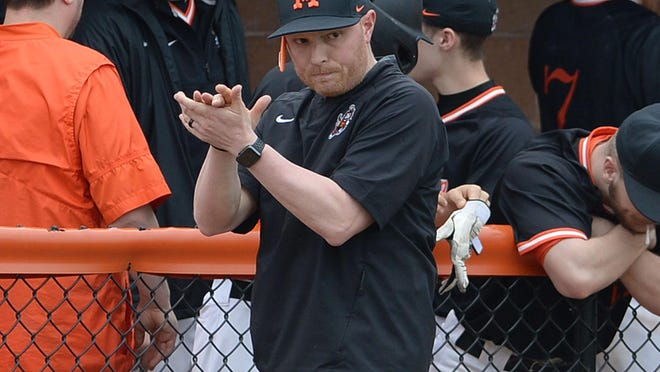 Massillon baseball coach Spike Ridgley applauds his team during a 2018 game against Canton South. Ridgley's Tigers are set to face Walsh Jesuit in a nine-inning exhibition game at Canal Park on July 18.