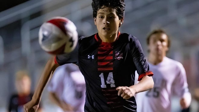 Lake Travis sophomore David Arellano, giving chase against Strake Jesuit, said his favorite type of soccer is played in La Liga in Spain because of the passing skills employed by its players.