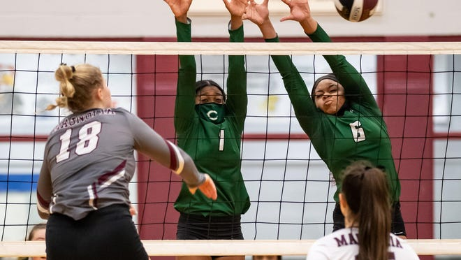 Connally's Michera Moffett, left, and Taylor Finley defend for Connally against the spike by Magnolia's Brynn Botkin. Connally lost a Class 5A area-round volleyball playoff match to Magnolia in three sets on Nov. 24 at Hearne High High.