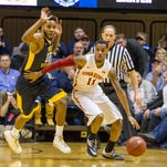 Iowa State Cyclones guard Monte Morris (11) dribbles past West Virginia Mountaineers guard Tarik Phillip (12) during the first half at the WVU Coliseum on Tuesday, Feb. 22, 2016, in Morgantown, W. Va.