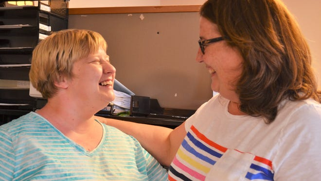 """Kaitlin Reed, left, talks with Patti Powers in the Fremont Easter Seals office. Reed will be an Honorary Ambassador during this year's """"Walk With Me"""" event at the Toledo Zoo. She has been an Easter Seals ambassador since she was a child."""
