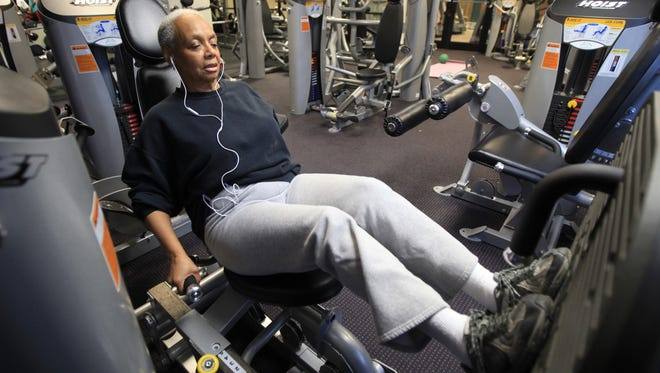 Mary Blake works out at the Clear Creek Family Activity Center in Shelbyville. Blake had her right ankle replaced with an implant.