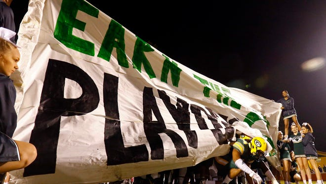 A Gallatin player crawls under the sign as his team enters the filed before their game against Page, Friday, Nov. 3, 2017, in Gallatin, Tenn. (Photo by Wade Payne, Special to the Tennessean)