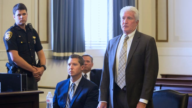 Defense attorney Stew Mathews addresses the court during a hearing for Ray Tensing, seated. Tensing is a former University of Cincinnati police officer who was charged with murdering Sam DuBose during a routine traffic stop on July 19, 2015. During two trials, jurors were unable to reach a verdict. Hamilton County Common Pleas Judge Ghiz formally dismissed the voluntary manslaughter and murder charges against Tensing Monday, July 24. Mathews argued for a acquittal, but Ghiz denied the request.