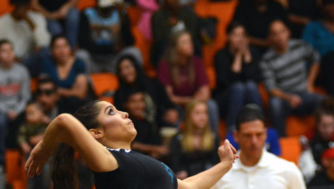 Oñate's Isabelle Silva serves against Mayfield for the district championship match on Saturday afternoon at Oñate High School.
