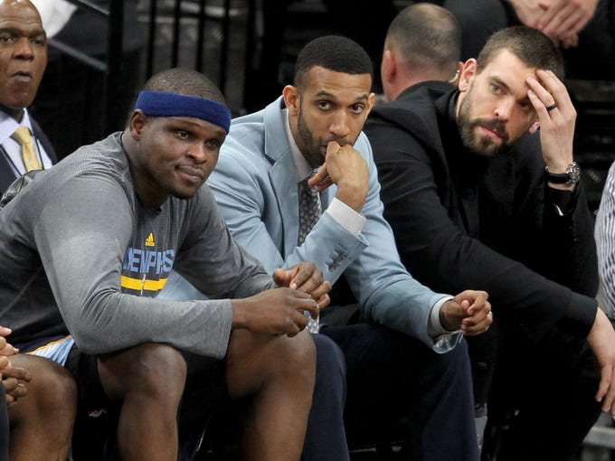 April 19, 2016 -   Memphis Grizzlies Zach Randolph, Brandan Wright, and Marc Gasol react during the second half against the San Antonio Spurs during Game 2 in San Antonio.