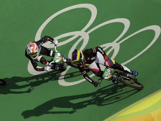 Mariana Pajon of Colombia, right, and Alise Post of the United States, left, compete to finish first and second respectively in the women's BMX cycling final during the 2016 Summer Olympics in Rio de Janeiro Friday.