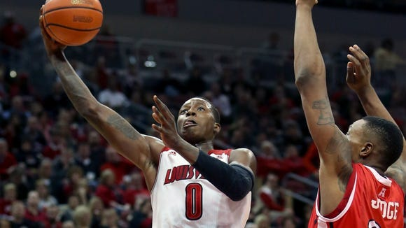 Louisville's Terry Rozier goes up for the basket against Rutgers' Wally Judge. Feb. 16, 2014.