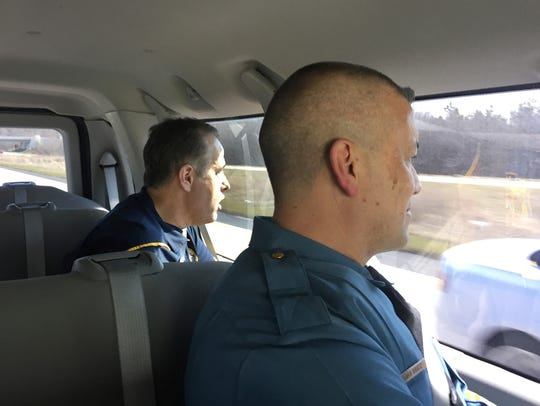 Delaware State Police Sgt. Tony Mendez and Sgt. Richard Bratz try to spot motorists not wearing seatbelts, texting, or talking on their cellphones during a distracted driving operation Thursday in Kent County.
