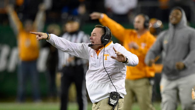 Tennessee coach Butch Jones yells out to his team during the closing minutes of the  Franklin American Mortgage Music City Bowl on Friday at Nissan Stadium.