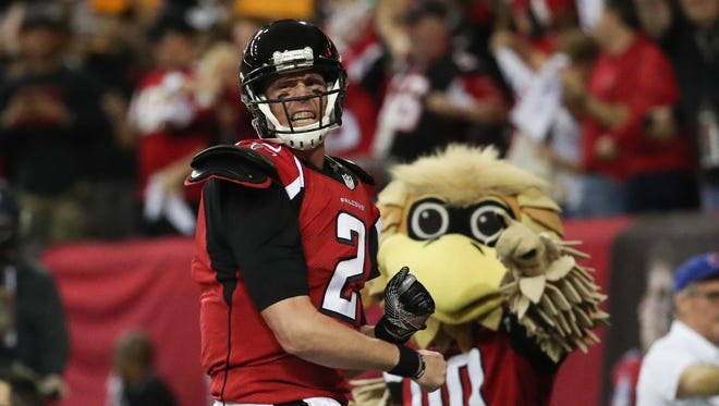 Atlanta Falcons quarterback Matt Ryan (2) celebrates a touchdown during the second quarter against the Green Bay Packers in the 2017 NFC Championship Game at the Georgia Dome.