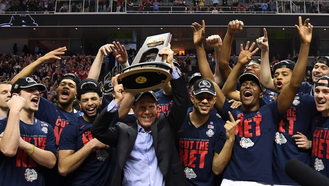 Mark Few and the Gonzaga Bulldogs celebrate their victory in the West Region final.
