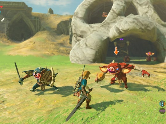 Link battles a group of goblin enemies in 'The Legend