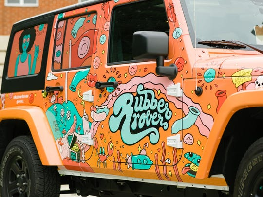 The Rubber Rover is a Jeep that's decorated to draw attention. It's part of a campaign to get young people to practice safer sex.