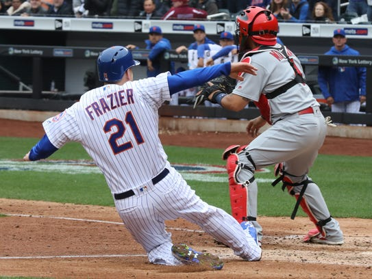 Todd Frazier slides into home scoring a fifth inning
